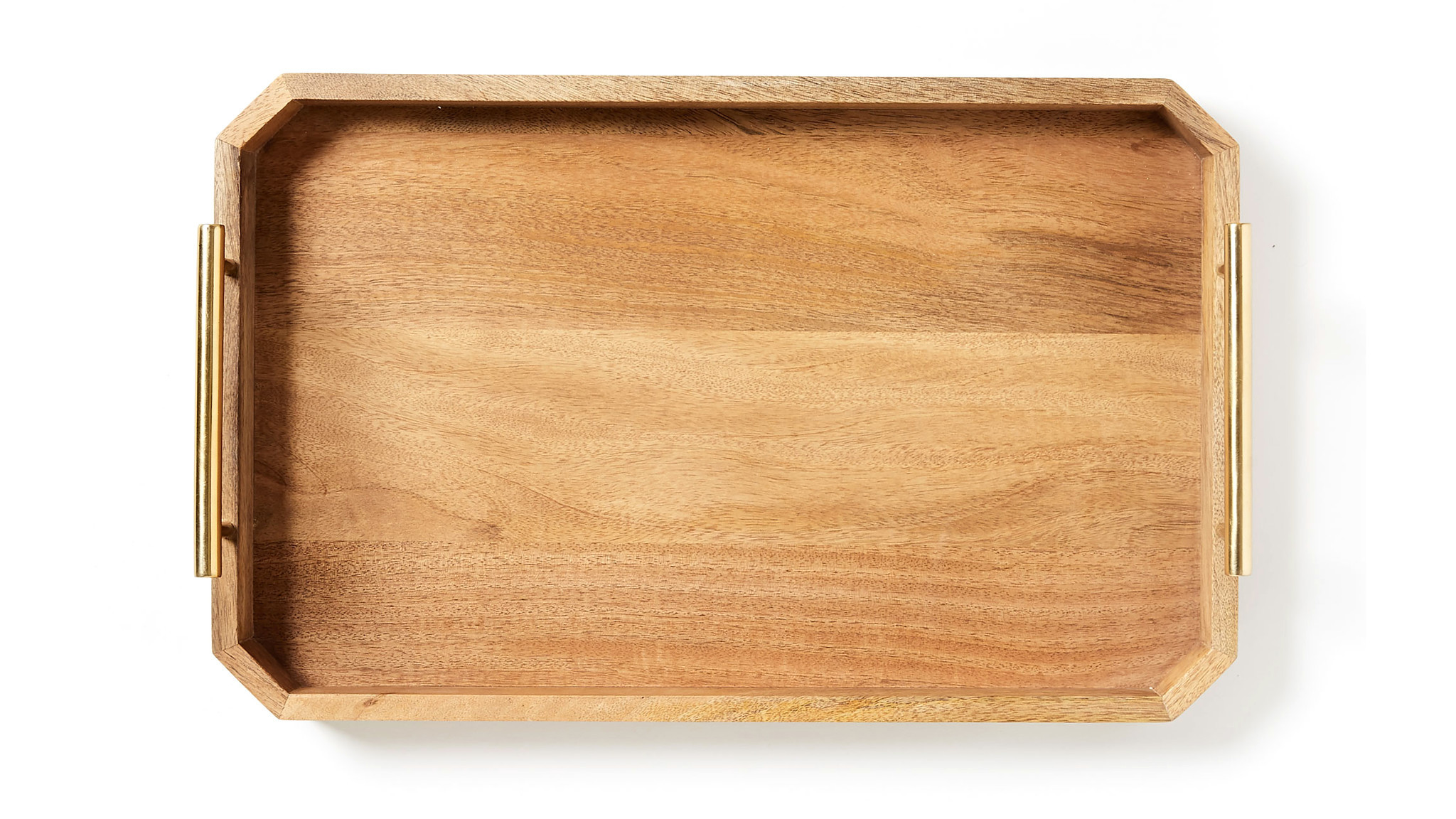 Deco Handle Tray. Made from solid mango wood, West Elm's brass-finished handled tray blends industrial- and deco-inspired style. Use this multi-tasker to organize your workstation or serve up breakfast in bed. $59 and $89. westelm.comPhoto credits: West Elm