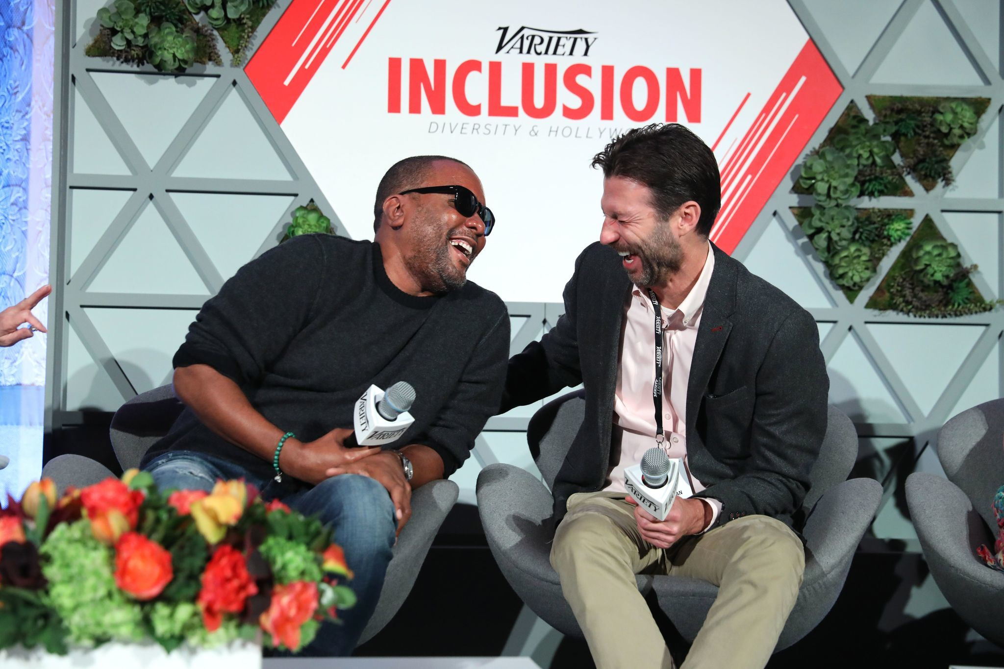 Director Lee Daniels and Participant Media President Jonathan King share a laugh at Variety's Inclusion summit in Los Angeles on Wednesday. (Andreas Branch / Variety / REX / Shutterstock)