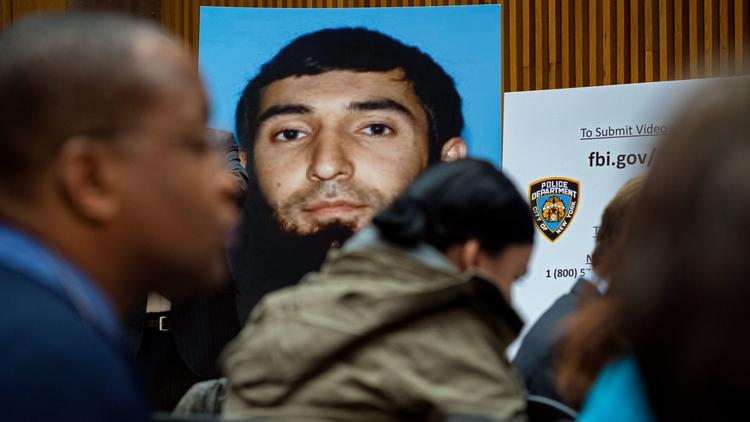 A photo of accused terrorist Sayfullo Saipov is displayed at a news conference after his arrest. (Craig Ruttle / Associated Press)