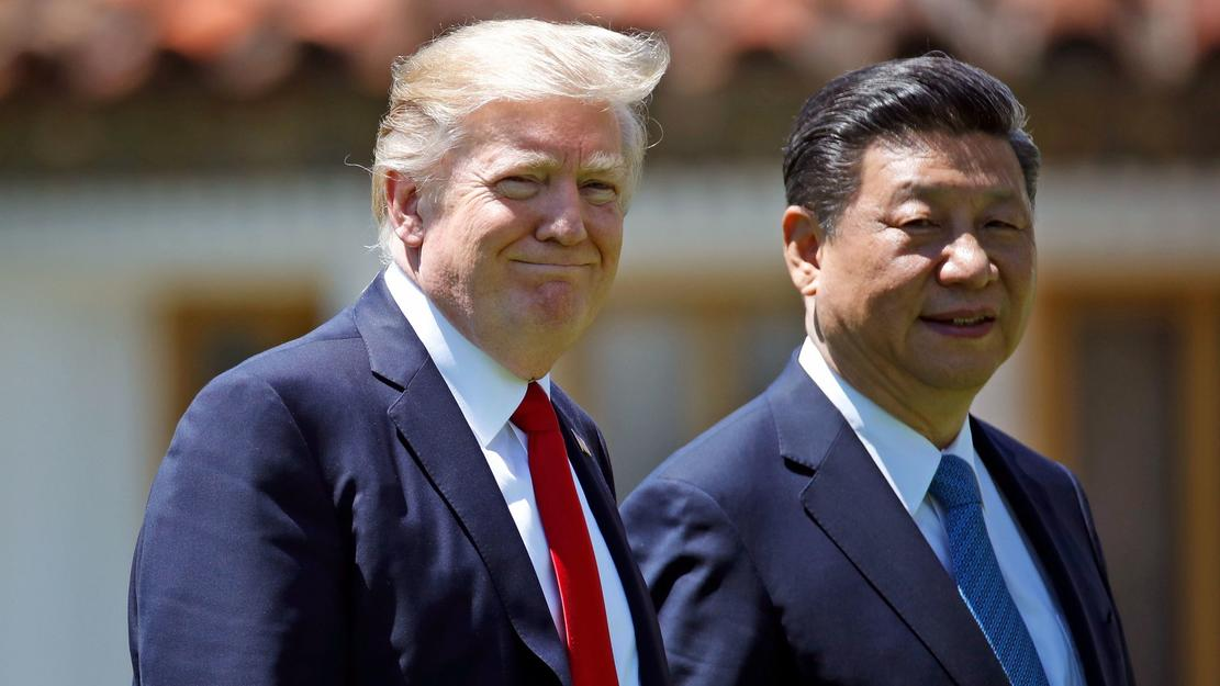 American President Donald J. Trump and Chinese President Xi Jinping walk together after their meetings at Mar-a-Lago in Palm Beach, Florida on April 7th, 2017. — Photograph: Alex Brandon/Associated Press.