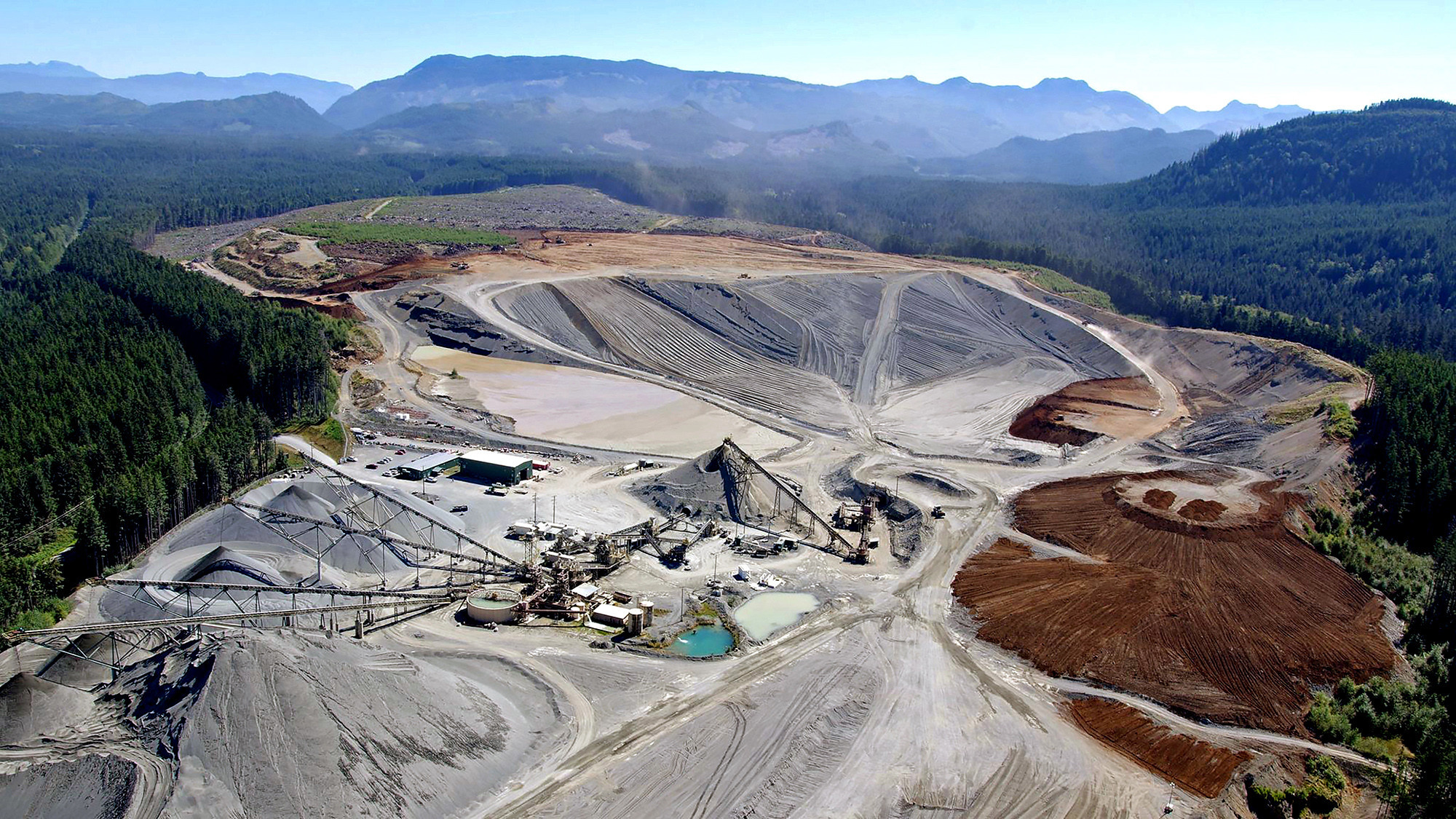At Polaris Materials' Orca quarry, located on the northern coast of Vancouver Island, gravel and sand are scraped from the sides of the pit.