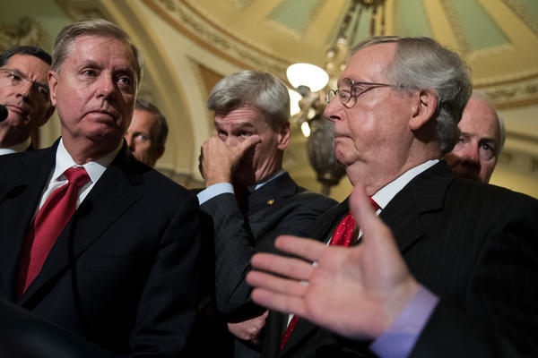 Senators Lindsey Graham (R-S.C.), Bill Cassidy (R-La.), and Majority Leader Mitch McConnell (R-Ky.) in Washington on Sept. 26. (Drew Angerer / AFP / Getty)