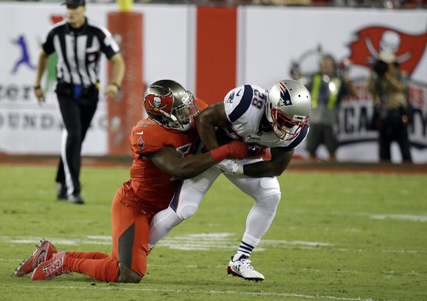Buccaneers rookie linebacker Kendall Beckwith tackles Patriots running back James White during the first half of a game on Oct. 5. (John Raoux / Associated Press)