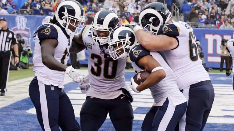 Rams Sammy Watkins (12), Robert Woods, center and Todd Gurley (30) accounted for five touchdowns against the Giants on Sunday at MetLife Stadium. (Bill Kostroun / Associated Press)