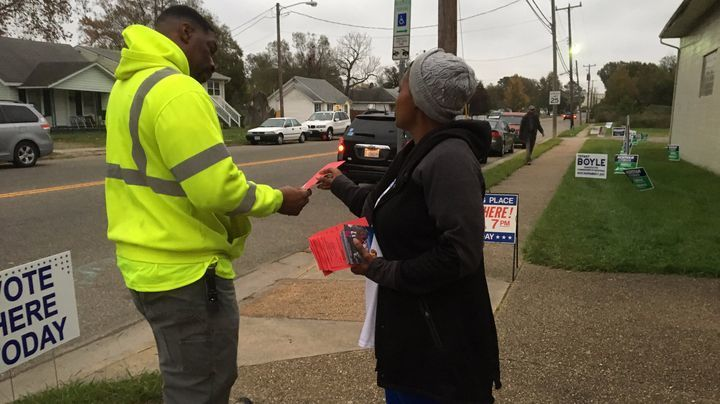 "Tarsha Frazier, a volunteer with the Tiffany Boyle campaign hands out flyers outside the Wilson precinct in Southeast Newport News. Frazier, who arrived about 5:30 a.m., said there haven't been lines, but early morning voting has been steady.  ""The people are coming in. They're coming."""