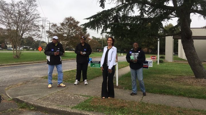 Commissioner of Revenue candidate Tiffany Boyle stands with volunteers outside the Newmarket precinct in Newport News.