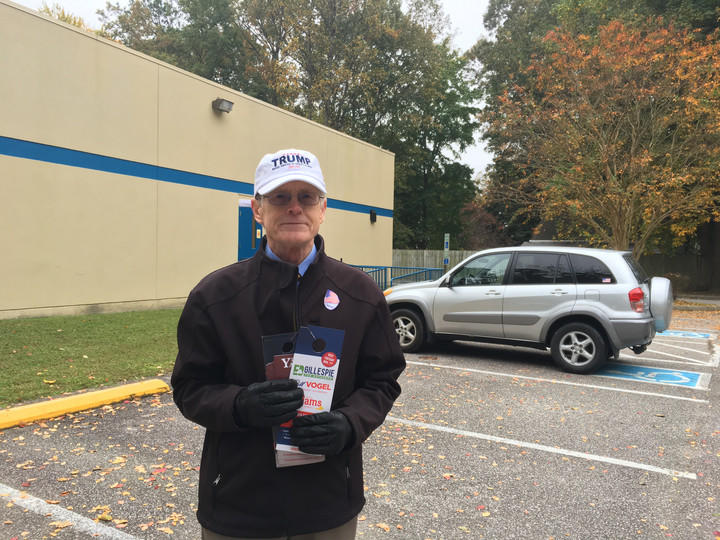 Robert Blount, a volunteer, stood outside passing out pamphlets for the Republican candidates at Moose Lodge in Newport News.
