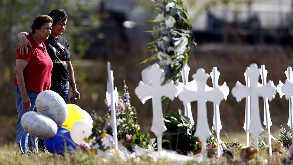 Maria Durand, left, and her daughter, Lupita Alcoces visit 26 crosses representing the 26 victims of the massacre at the First Baptist Church of Sutherland Springs, Texas. — Photograph: Larry W. Smith/European Pressphoto Agency/Agencia-EFE.
