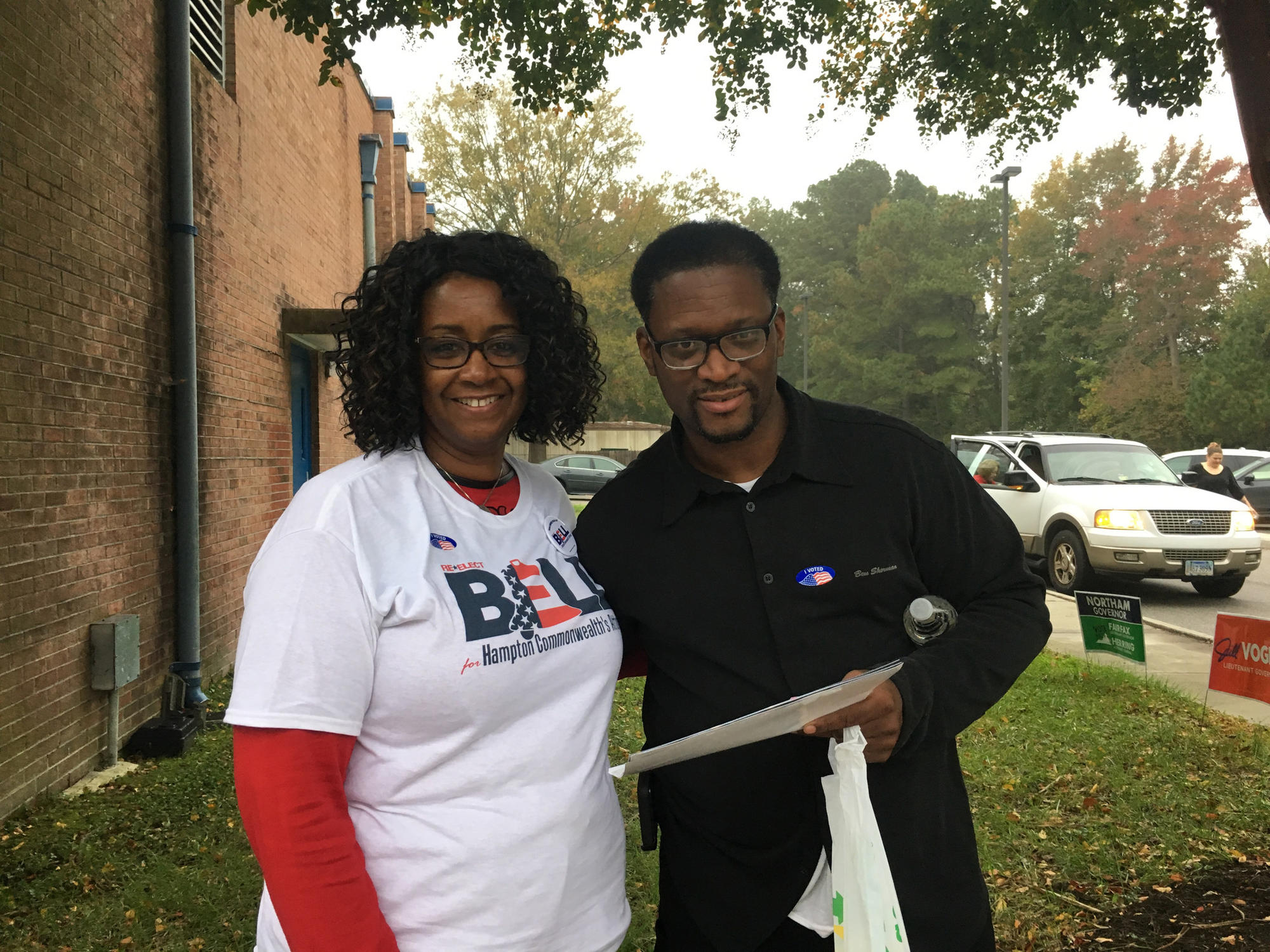 Natalie Christian and Malcolm Hill, volunteers outside Kraft Elementary School, handed out sample ballots. Christian was volunteering for Commonwealth's Attorney candidate Anton Bell.