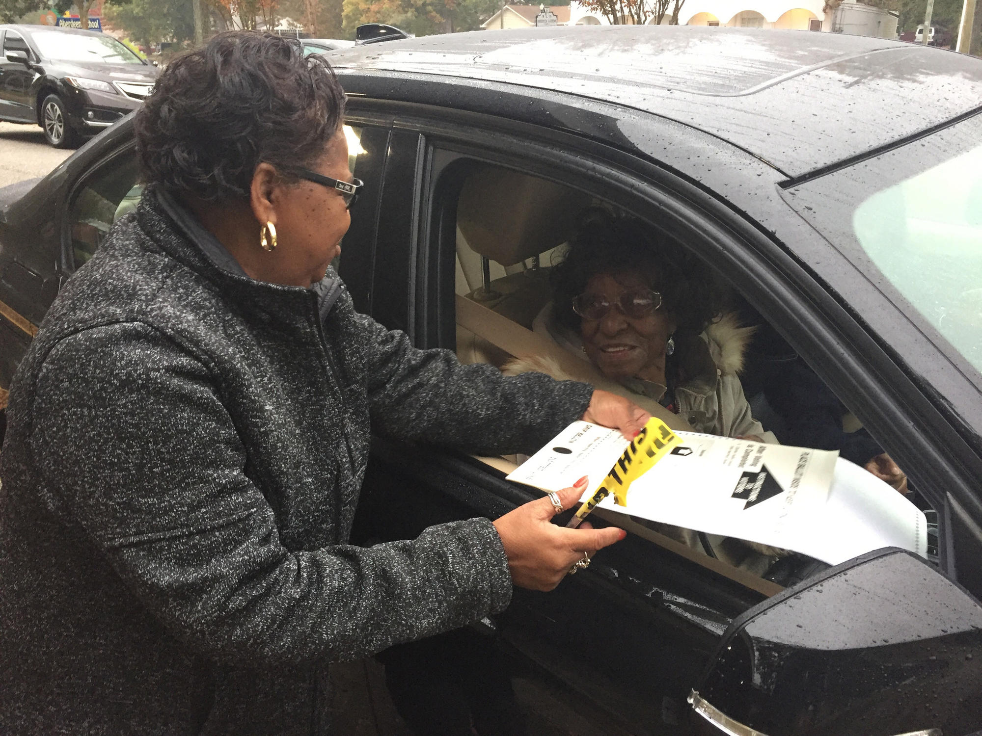 More than 30 people have cast curbside ballots at the Aberdeen precinct in Hampton Tuesday. Rev. Bertese Booker, 92, was one of those getting the curbside treatment, provided here by poll worker Brenda Perry.