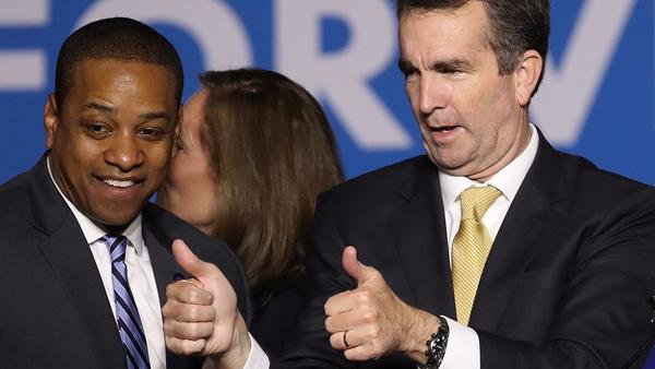 Gov.-elect Ralph Northam, right, and Lt. Gov.-elect Justin Fairfax greet supporters at a Democratic election night rally in Fairfax, Va. (Win McNamee / Getty Images)