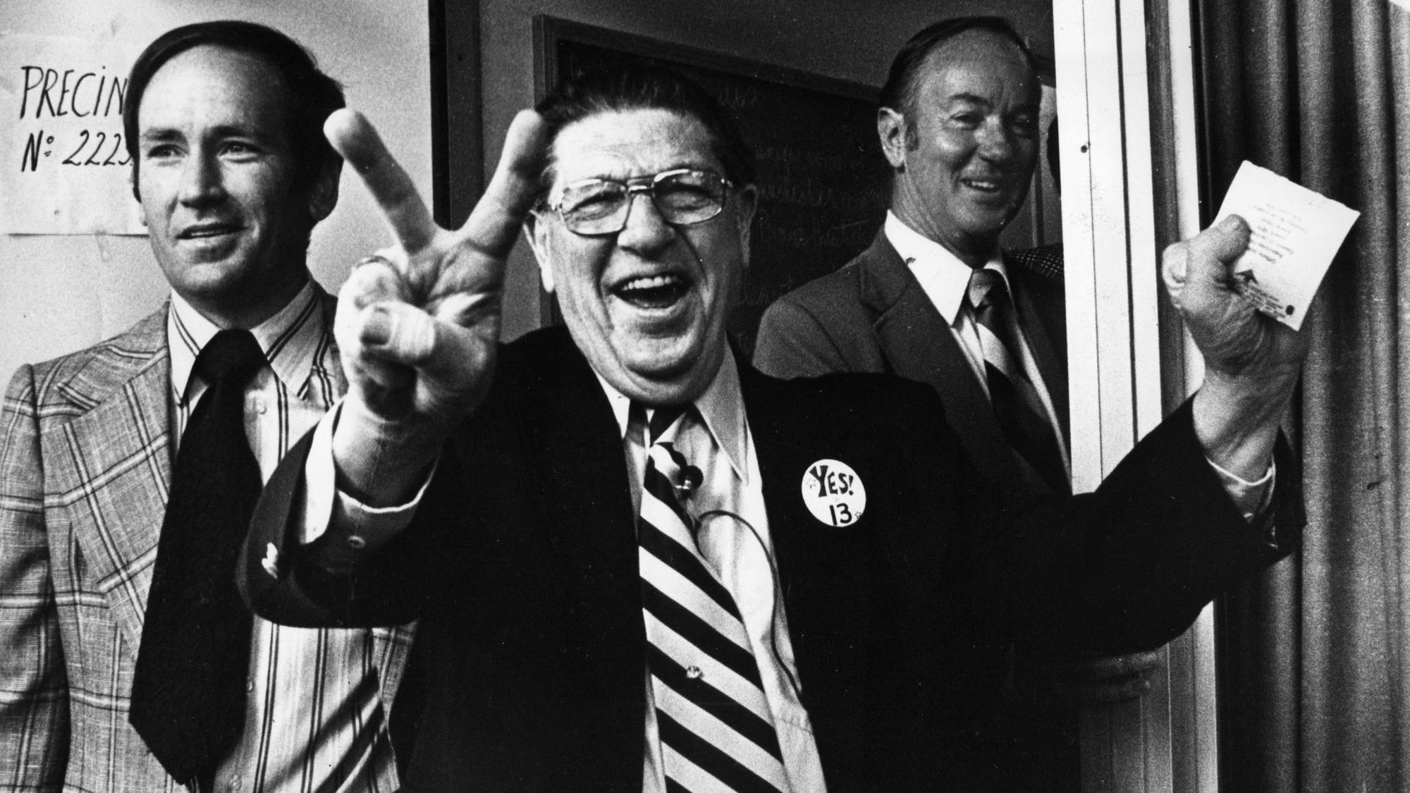 Howard Jarvis, chief sponsor of the controversial Proposition 13, signals victory as he casts his ow