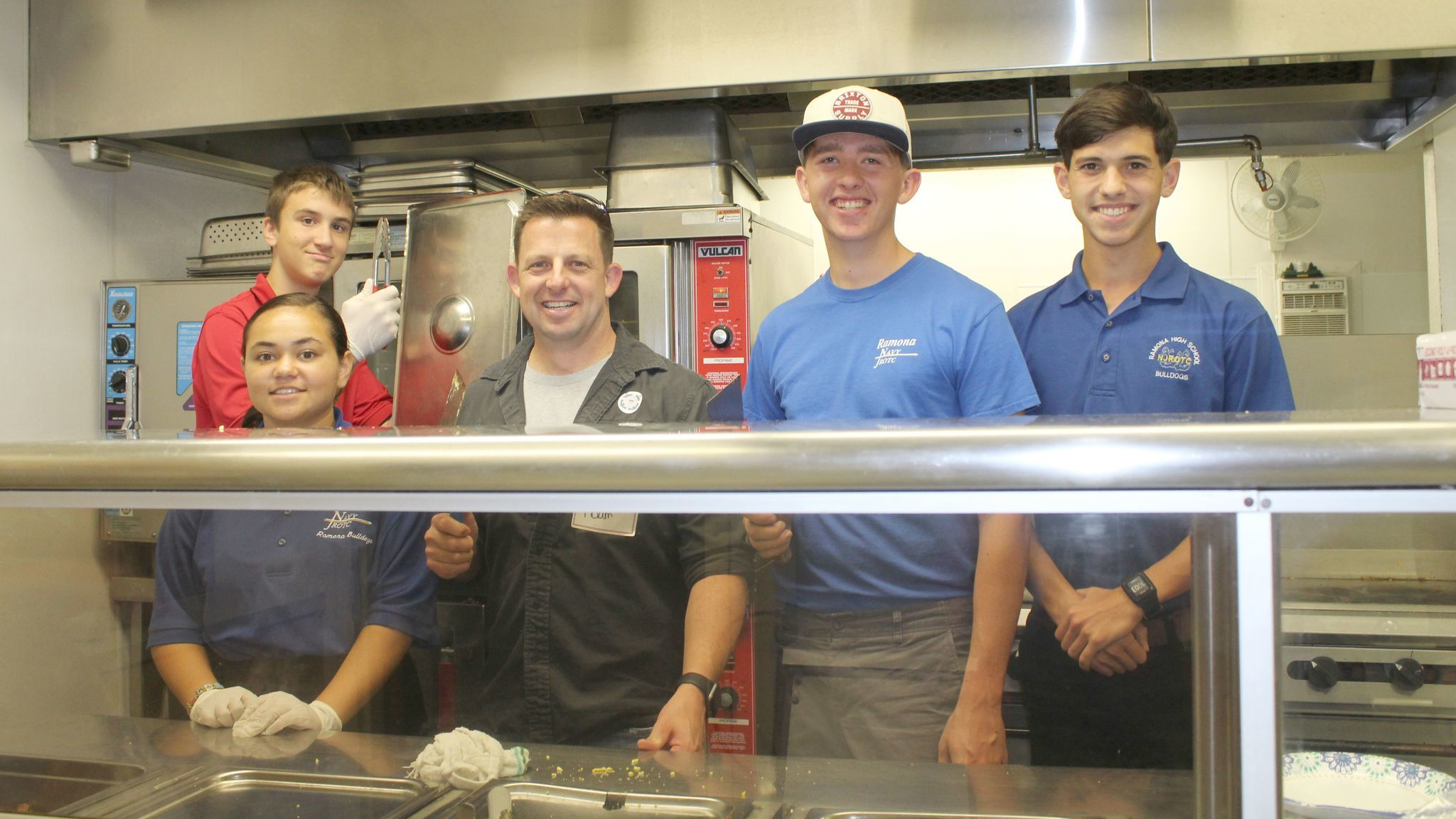 Ramona High School Senior Naval Science Instructor and U.S. Coast Guard Lt. Cmdr. Adam Birst, retired, spends time in the kitchen with NJROTC cadets Michael Smith, Sina Ward, Patrick Myers and Gavin Roche.