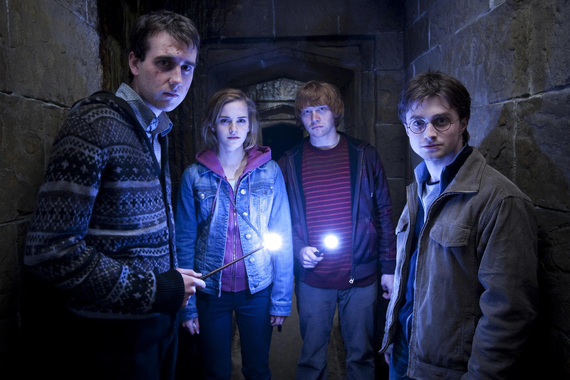 "Matthew Lewis, left, Emma Watson, Rupert Grint and Daniel Radcliffe appear in a scene from ""Harry Potter and the Deathly Hallows — Part 2."" (Jaap Buitendijk / Warner Bros.)"