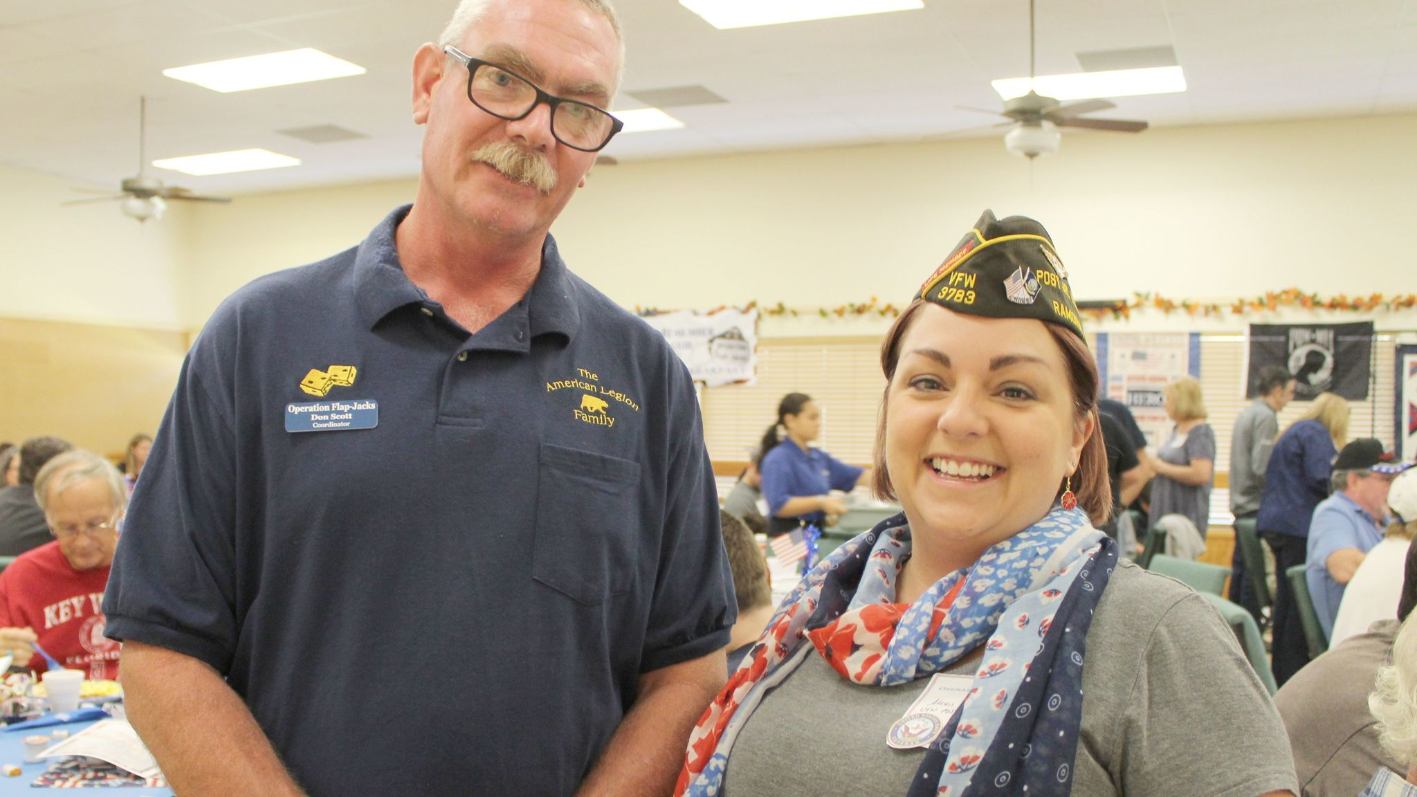Ramona VFW Post 3783 Cmdr. Alexis Henshaw talks with Boy Scout Troop 768 Assistant Scoutmaster Don Scott, an American Legion Post 332 member.