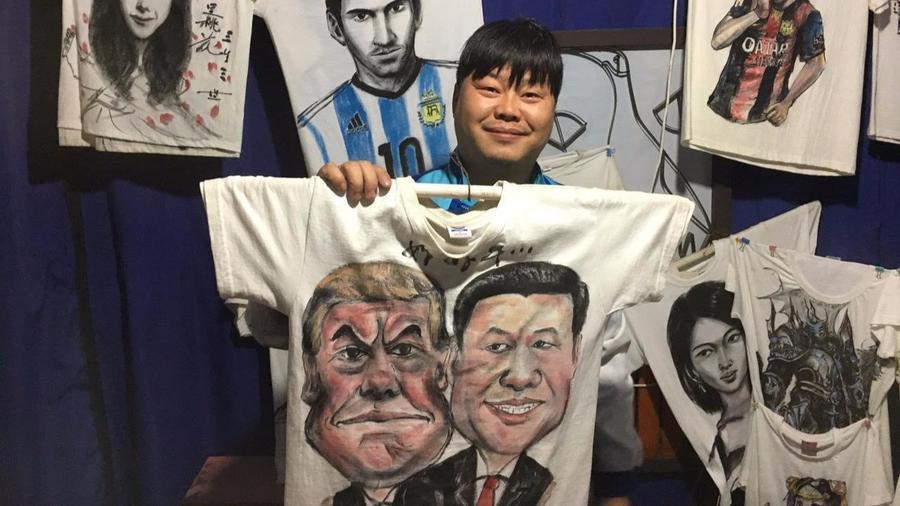 Beijing-based caricature artist Zheng Shenghui shows off his wares. — Photograph: Matt DeButts/Los Angeles Times.