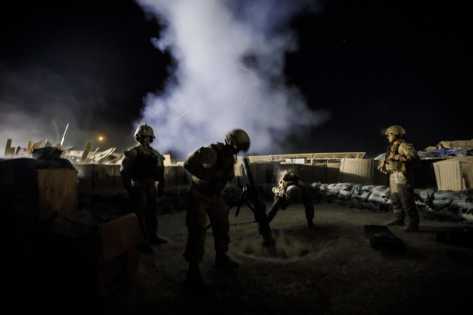 U.S. Marines fire illumination mortar rounds from Camp Shorab in Helmand Province.