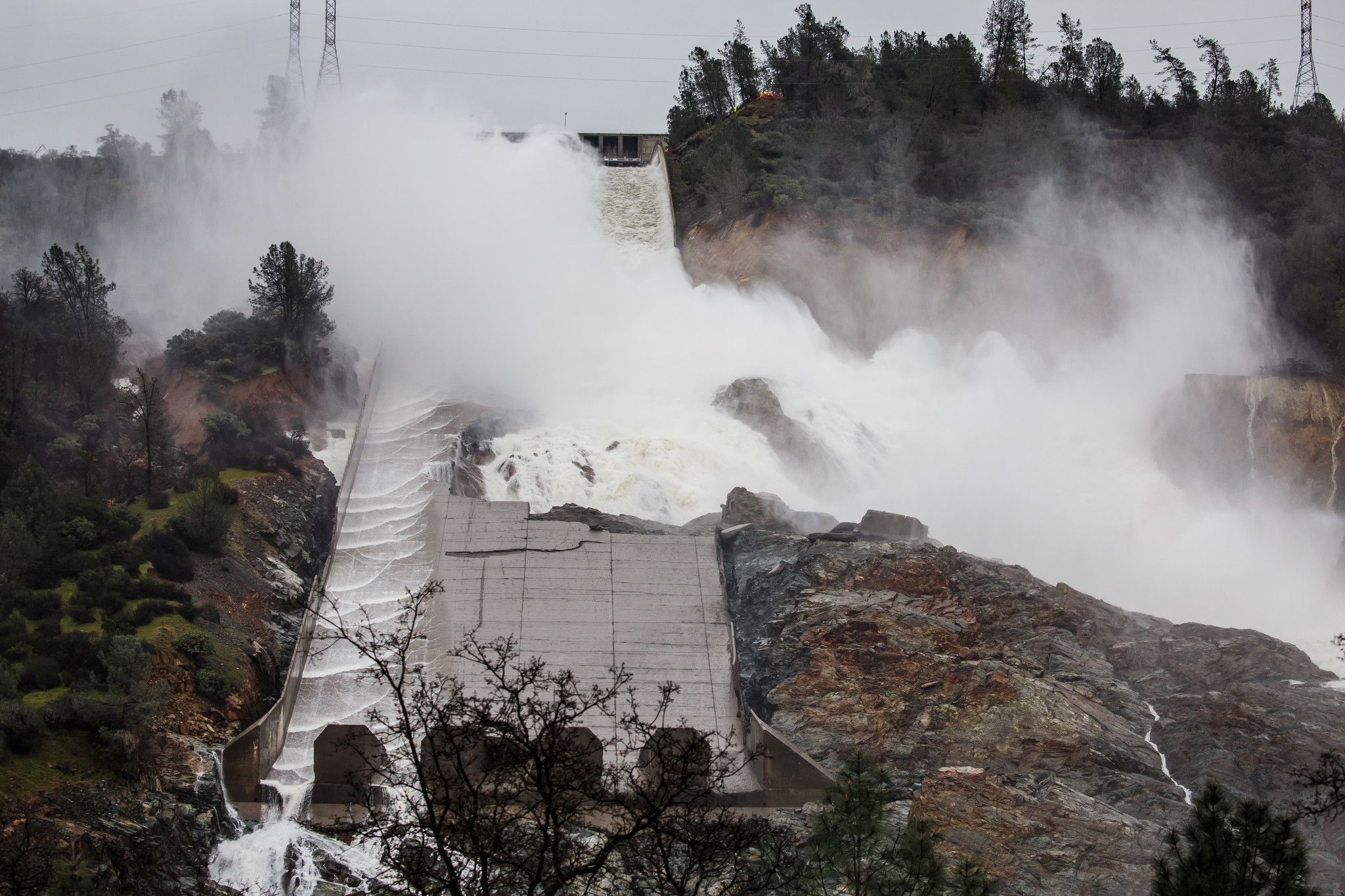 Water flow is barely flowing down the main spillway in Oroville on on Feb. 19 days after the spillway crumbled and an emergency spillway nearly failed.