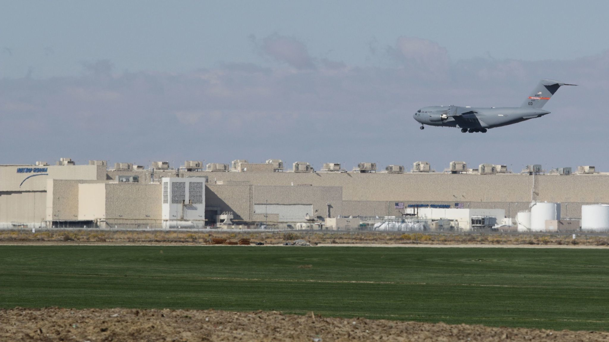 A Boeing C-17 Globemaster III lands at Palmdale Regional Airport during recent exercise flights. Northrop Grumman (background) was awarded the new B-21 bomber contract in 2015.