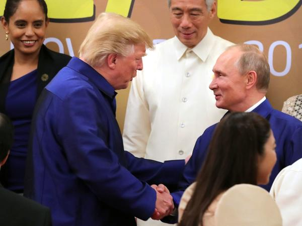 President Trump shakes Russian President Vladimir Putin's hand before a group photo session at the APEC summit in Vietnam. (Michael Klimentyev/Sputnik/Kremlin pool/Pool/EPA-EFE/REX/Shutterstock)