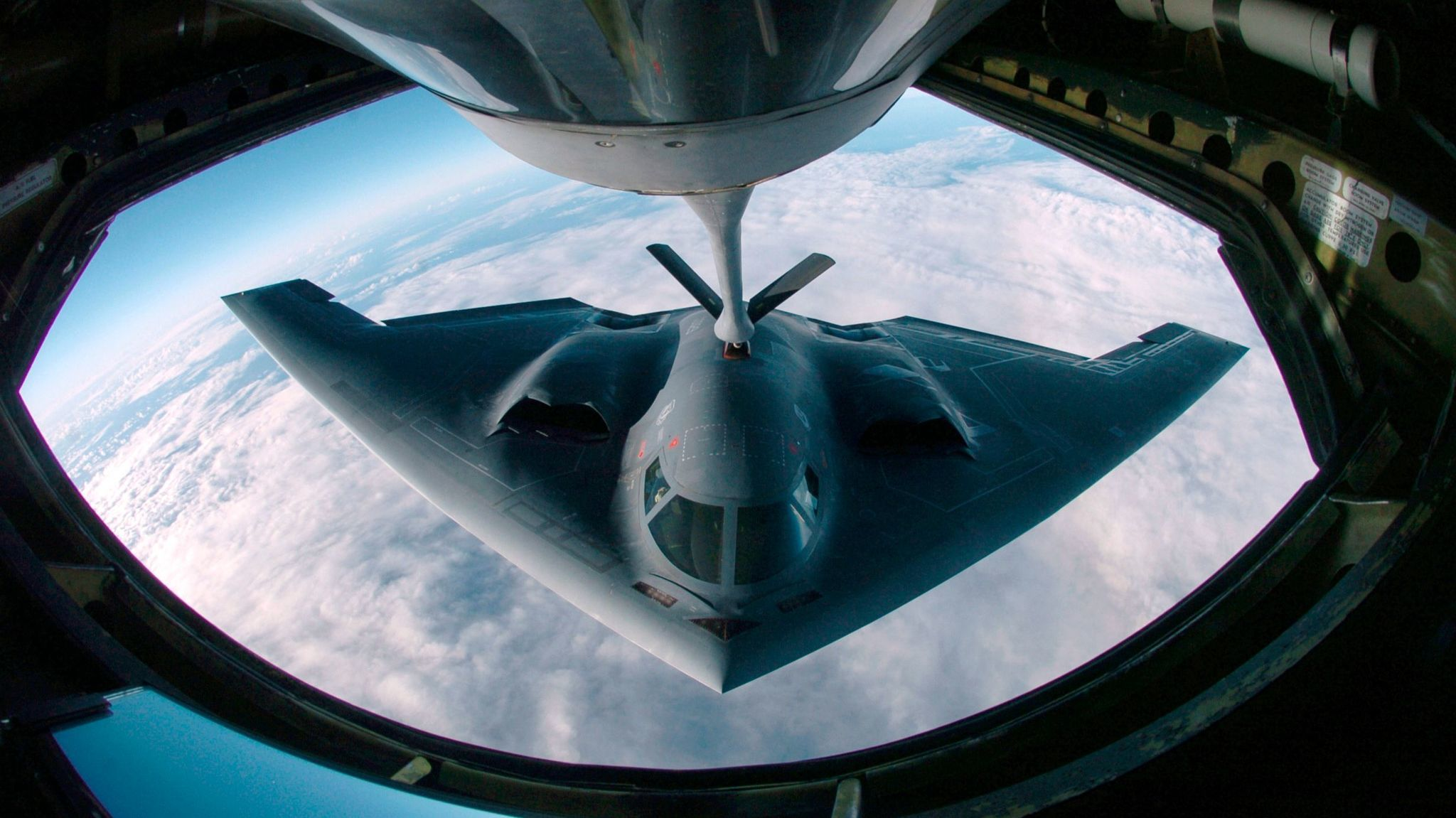 A B-2 bomber refueling from a KC-135 Stratotanker over the Pacific Ocean. The B-21 will be designed to be even stealthier than the B-2.