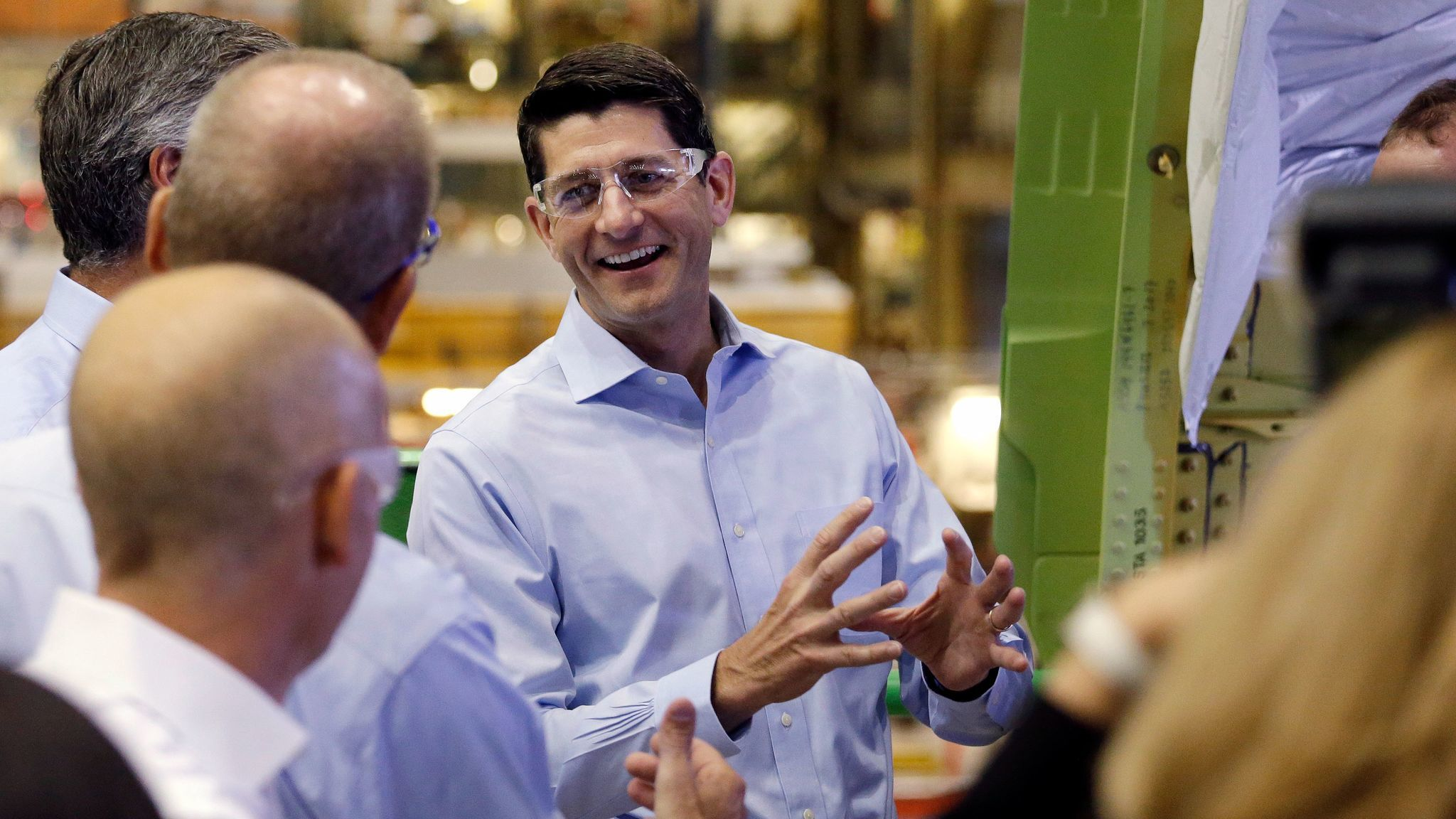 House Speaker Paul D. Ryan (R-Wis.) talks with Boeing Co. employees while on a tour of the airplane factory in Everett, Wash., in August.