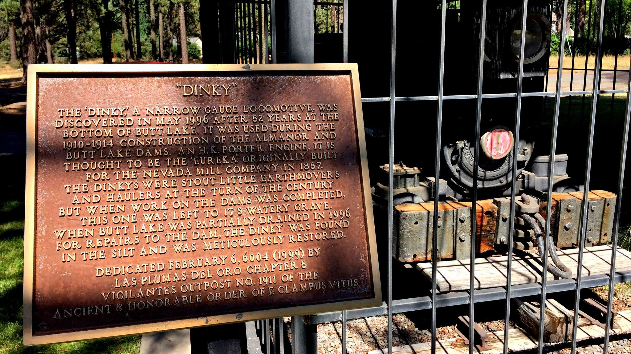 A plaque placed by E Clampus Vitus stands beside the Butt Lake Dinky in Chester, Calif.