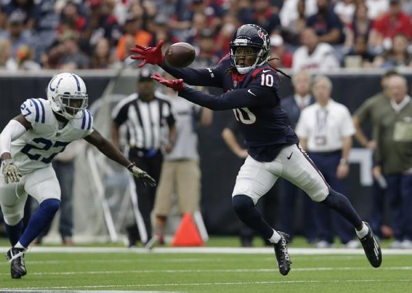 Texans receiver DeAndre Hopkins stretches out to make a catch during a game against the Colts on Nov. 5 at NRG Stadium. (Tim Warner / Getty Images)