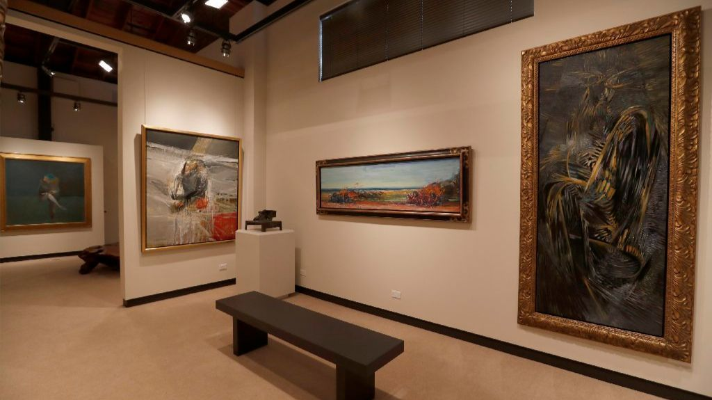 Buck never lost his taste for florid Baroque framing, even on Expressionist paintings by, from left, Nathan Oliveira, Carlos Almaraz and Wolfgang Paalen. A small Peter Voulkos bronze stands on a pedestal at the center.
