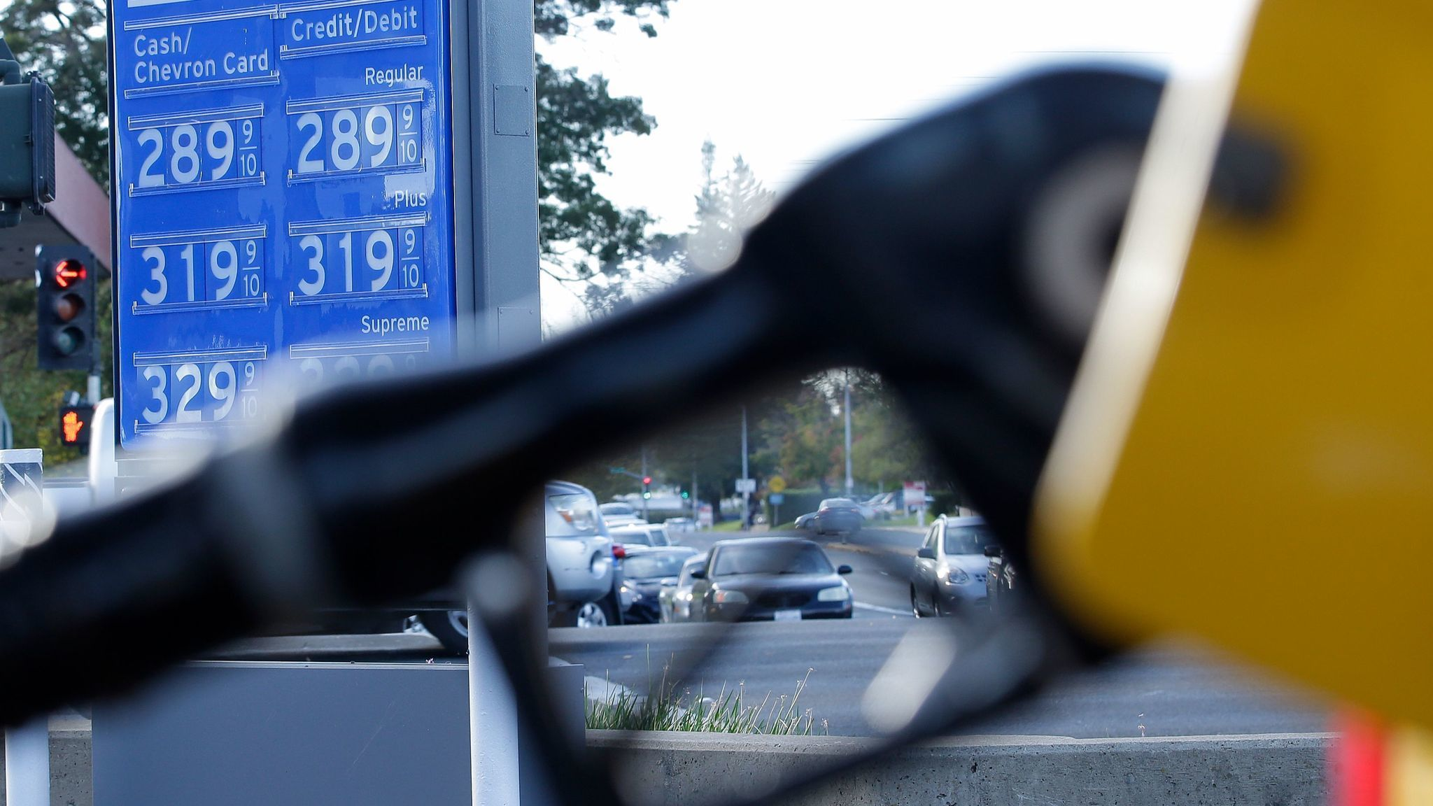 Gas prices are displayed at a Chevron station in Sacramento two days before the state gas tax was increased by 12 cents a gallon. (Rich Pedroncelli / Associated Press)