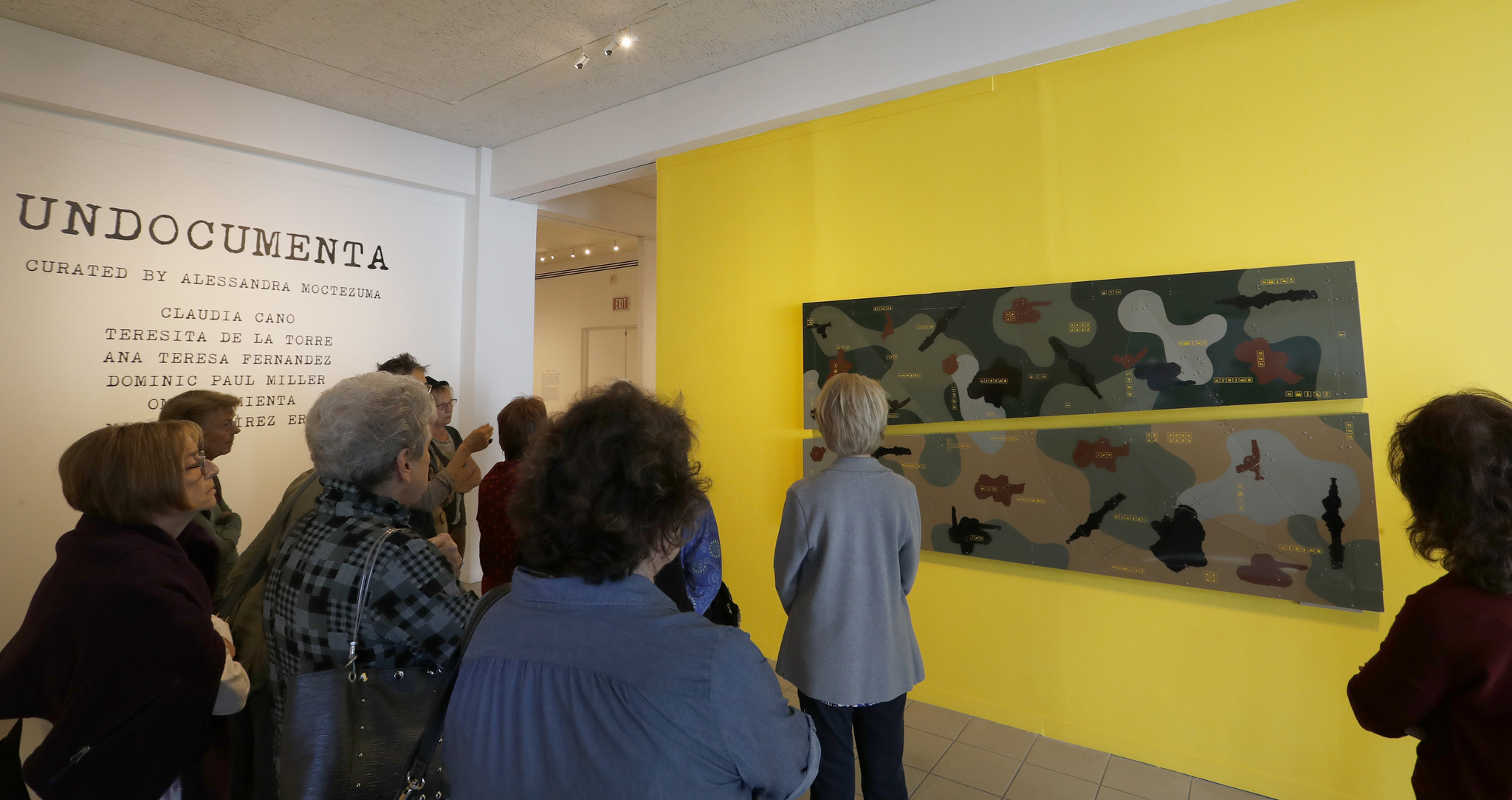 "An audience gathers at the exhibition ""UnDocumenta"" at the Oceanside Museum of Art."
