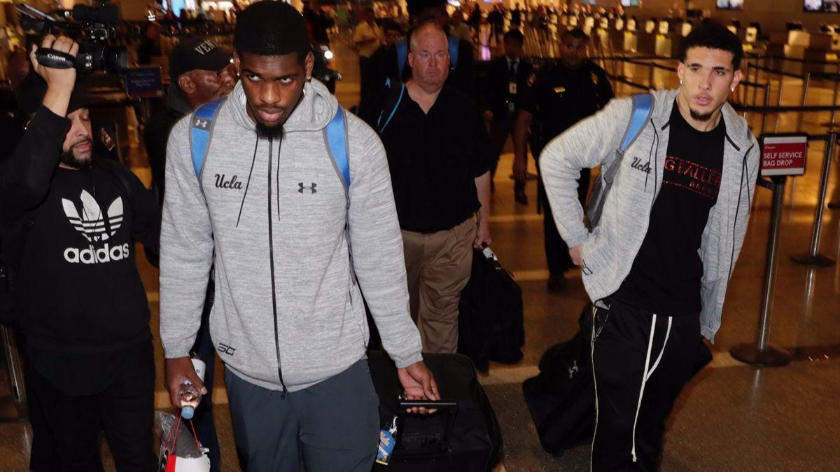 UCLA basketball trio arrives home from China; Trump calls their actions 'unfortunate'