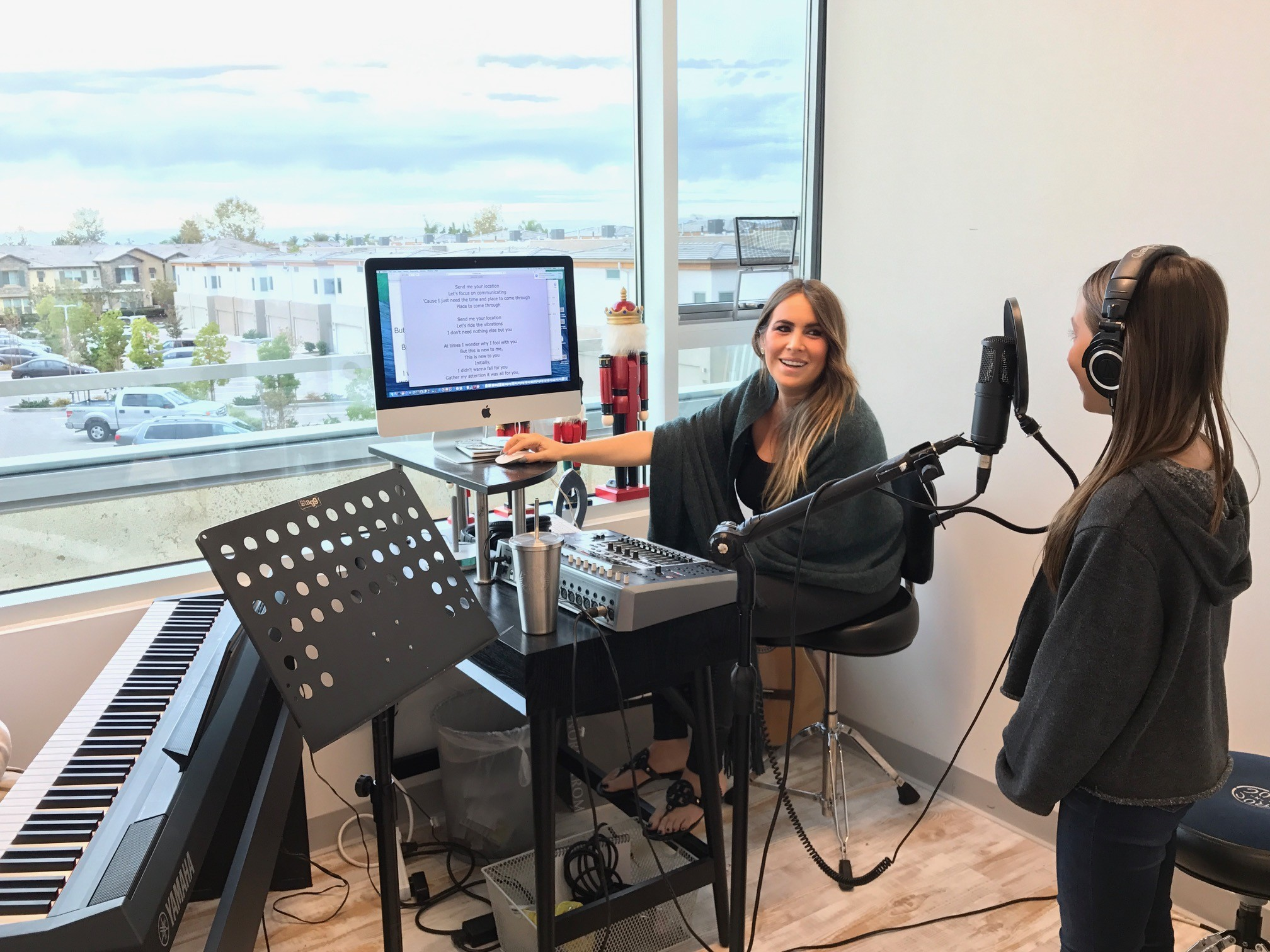 A student gets a voice lesson in the new studio.
