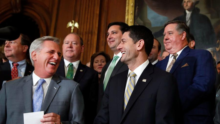 House Majority Leader Kevin McCarthy of Bakersfield, front left, and House Speaker Paul D. Ryan talk with reporters about the GOP tax plan. (Jacquelyn Martin / Associated Press)