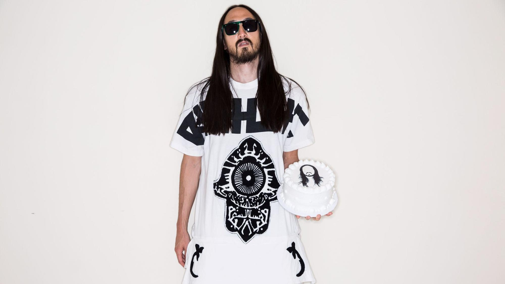 "Grammy-nominated music producer, DJ and EDM musician Steve Aoki, seen here in 2014, has been known for ""caking"" fans at his packed shows. Now he's diving deep into fashion."