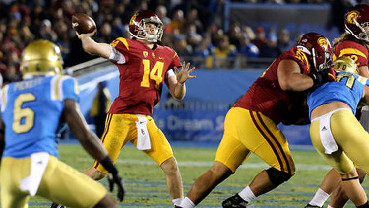 Sam Darnold and USC still have the Pac-12 title game and a bowl game to play after meeting UCLA in the annual rivalry game on Saturday. The Bruins, meanwhile, need a win to be bowl eligible. (Wally Skalij / Los Angeles Times)