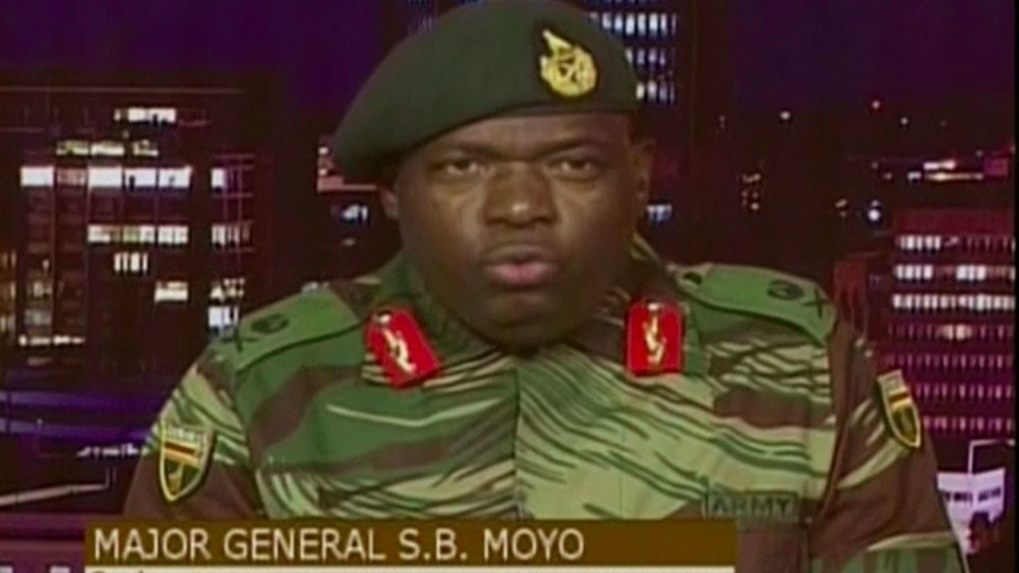 In this image made from video, Major Gen. S.B. Moyo, Spokesperson for the Zimbabwe Defense Forces ad
