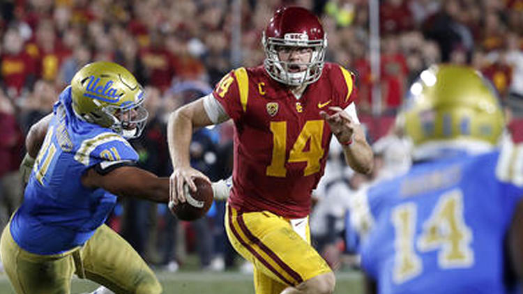 USC quarterback Sam Darnold scrambles during the second quarter. To see more images from the game, click on the photo above. (Luis Sinco / Los Angeles Times)