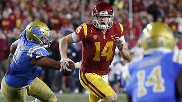 UCLA puts up a fight, but USC gets the victory in rivalry game