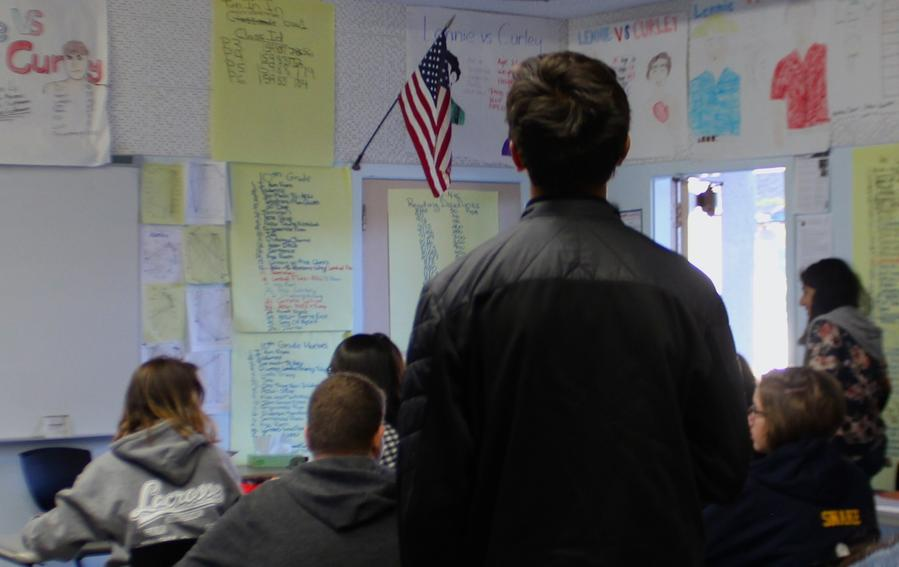 During the Pledge of Allegiance at Daniel Pearl Magnet High School, many students across different classrooms choose to not stand. (Richard Mendiola / HS Insider)