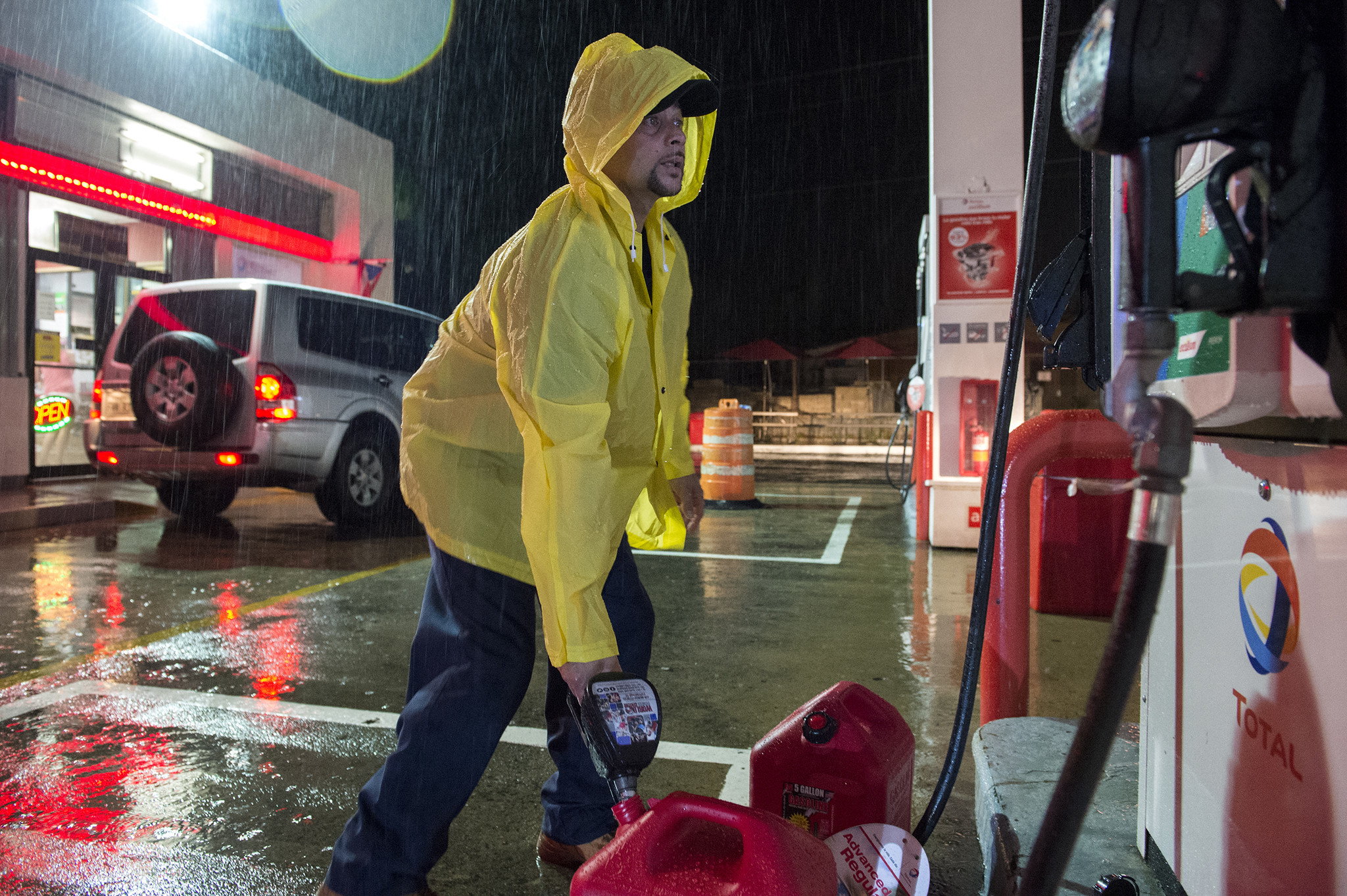 Jimmy Velasquez, 44, of East Hartford, fills up gasoline containers before the team