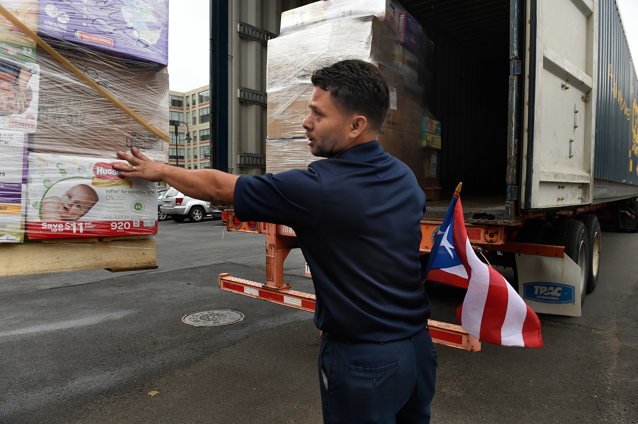 At a warehouse in Hartford, Jimmy Velasquez directs a pallet of supplies being loaded into a shipping container bound for Puerto Rico. Velasquez and his team loaded the container about a week before heading down to the island themselves.