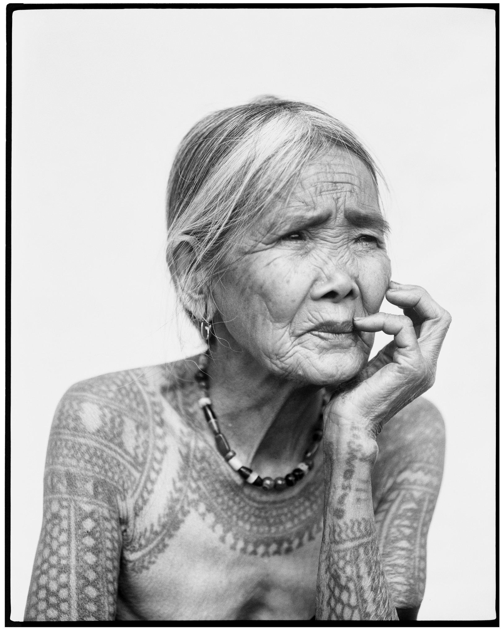 An image of almost 100 year-old Apo Whang-od Oggay, one of the last mambabatok (master tattooers) a