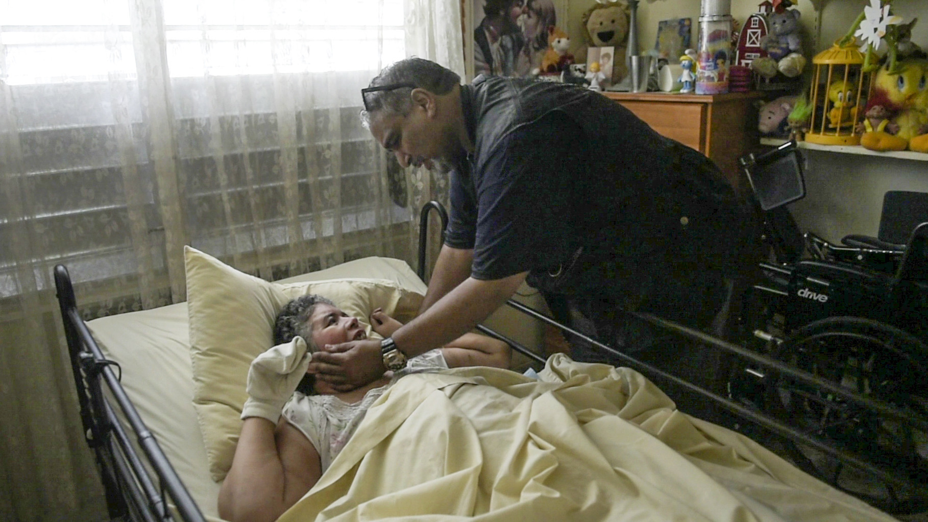 Elliot Matos greets his niece Bernadette de Jesus during a visit to her home in Vega Baja, Puerto Rico. De Jesus has Williams syndrome, a developmental disorder. Matos visited her and his sister Raquel to deliver water, solar panels and other supplies in the wake of Hurricane Maria.
