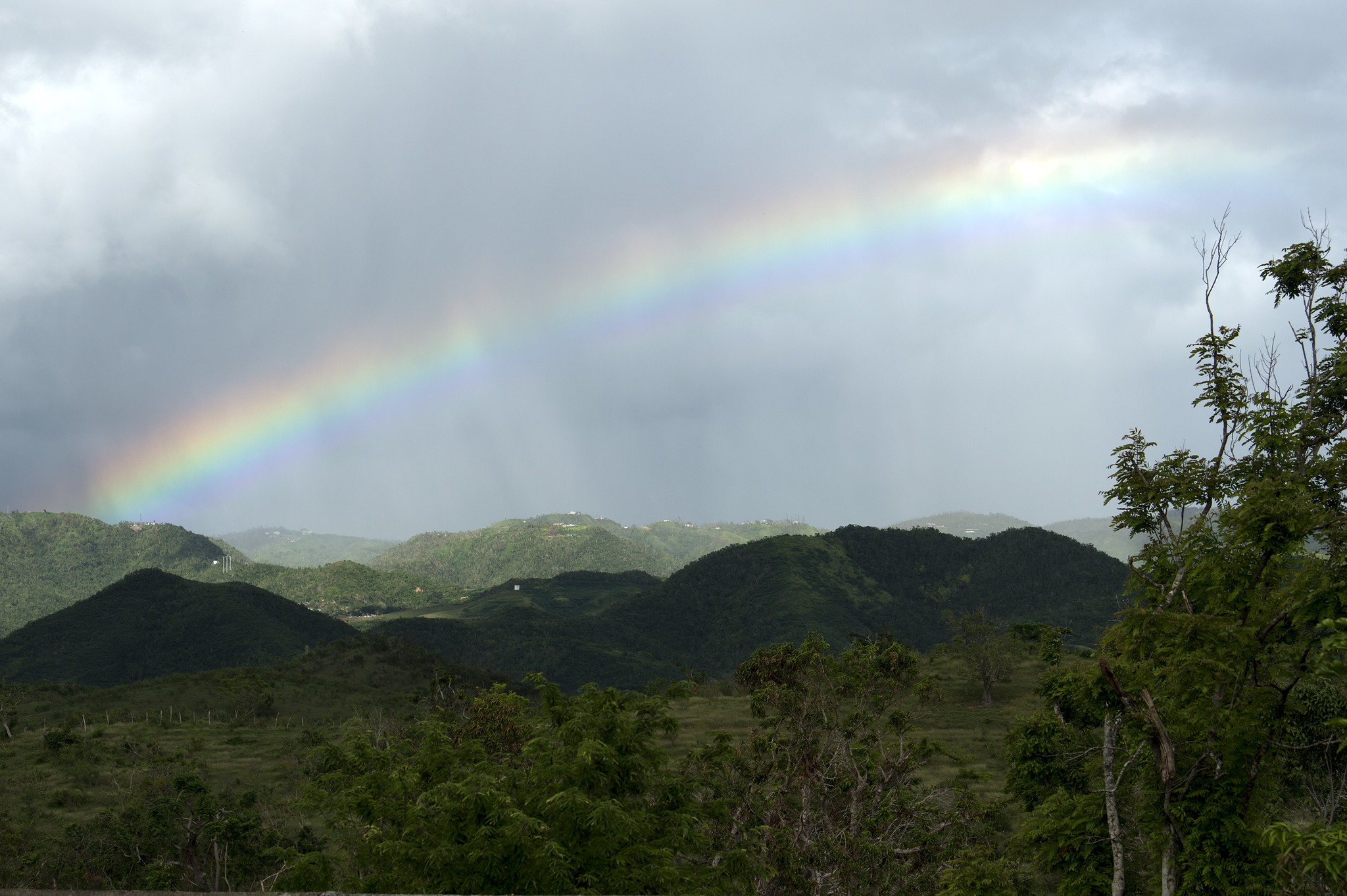 A rainbow emerges over the mountains of Coamo, Puerto Rico on the final day of the team