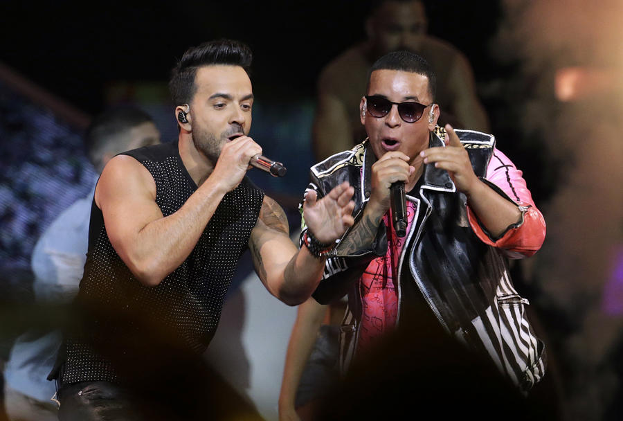 Singers Luis Fonsi, left, and Daddy Yankee perform during the Latin Billboard Awards in Coral Gables, Fla. (Lynne Sladky)