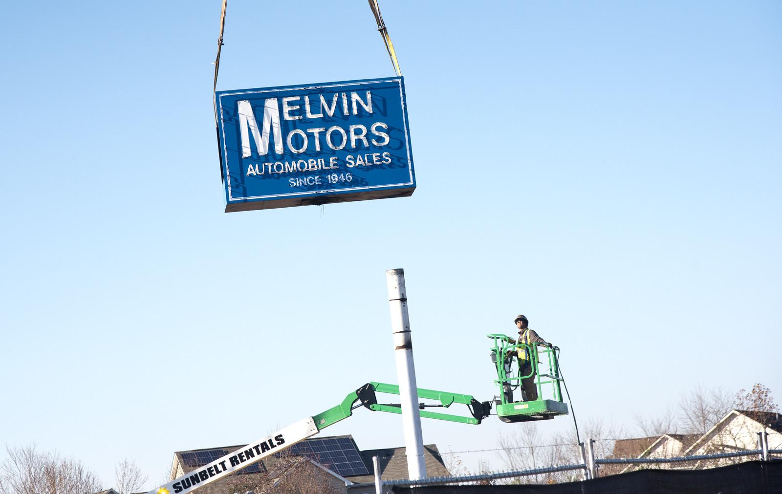 Melvin Motors sign comes down
