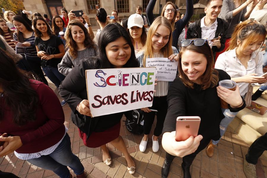USC graduate students, from left, Mariel Bello, Nina Christie and Alyssa Morris pose for a selfie to post. (Al Seib / Los Angeles Times)