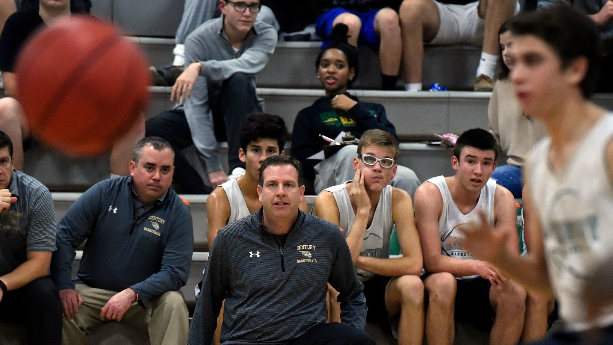 Century Boys Basketball Coach George Wunder watches his team in a scrimmage with a Reservoir Novembe
