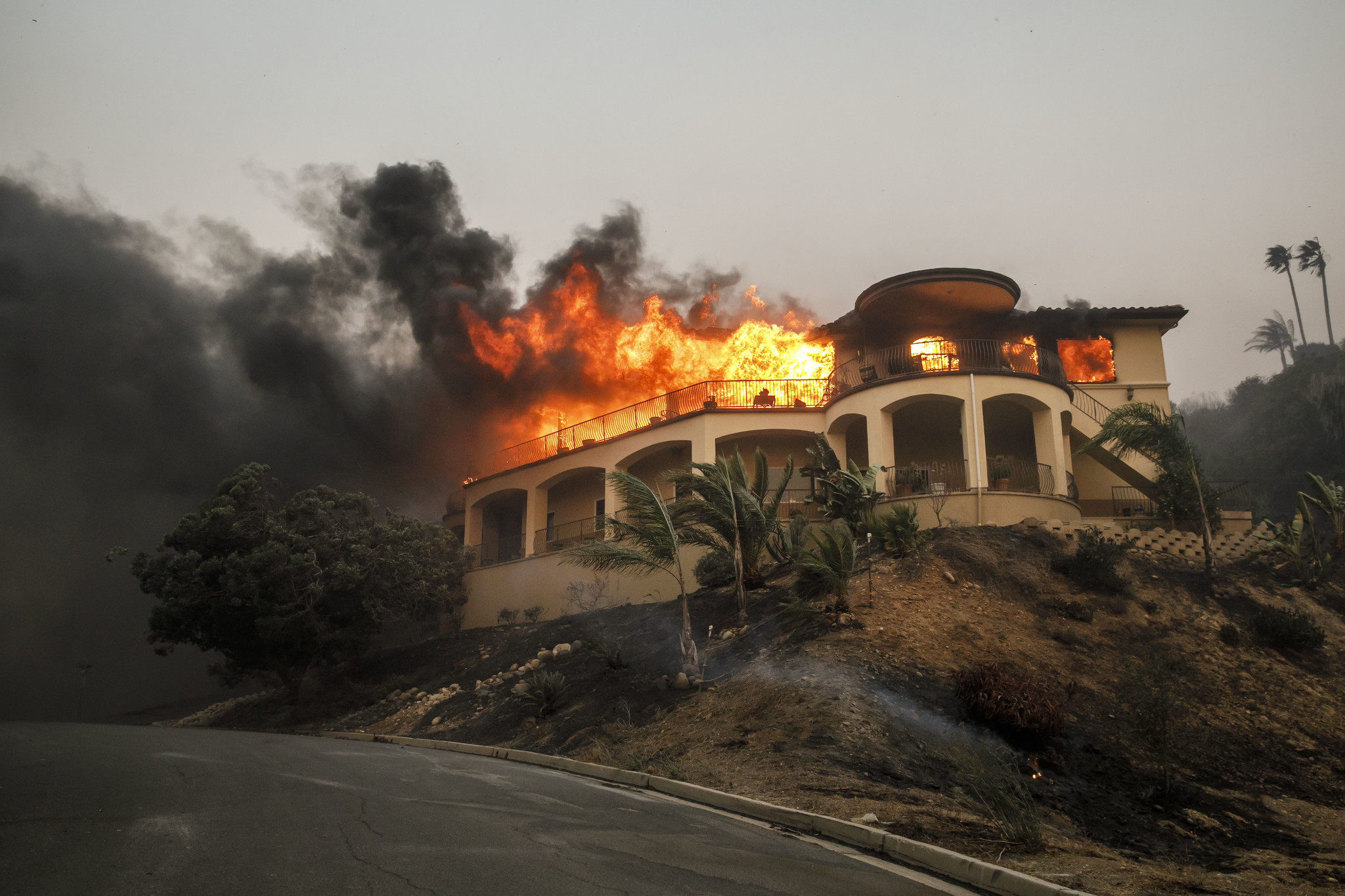 A home is engulfed in flames as the Thomas fire continues to burn in Ventura County. (Marcus Yam / Los Angeles Times)